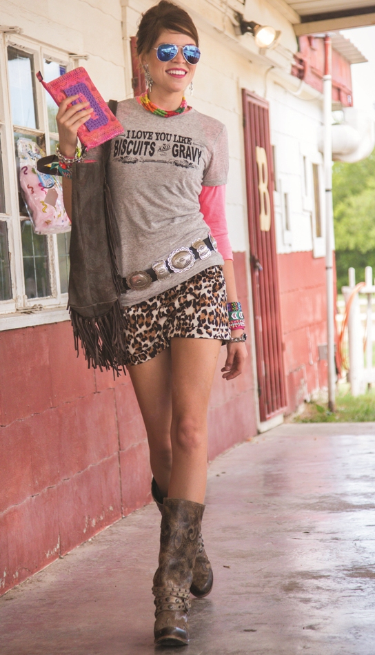 Cowgirl Justice grey t-shirt layered over Annette's Touch of Class pink baseball tee; Cowgirl Justice shorts; Kippys purse; Gypsy Soule clutch; Bilagaanas silver concho belt; Rhed Lucy necklace; Gypsy Soule bracelets; West & Co earrings; and Lane boots.