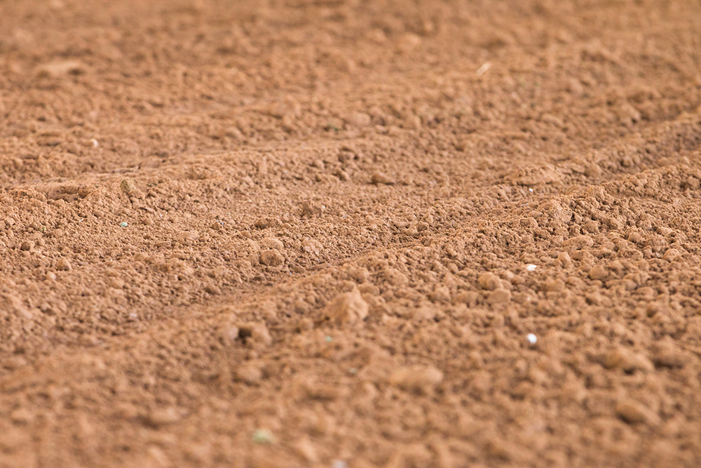 Good barrel racing footing requires the proper materials, moisture, and maintenance to ensure safe conditions.