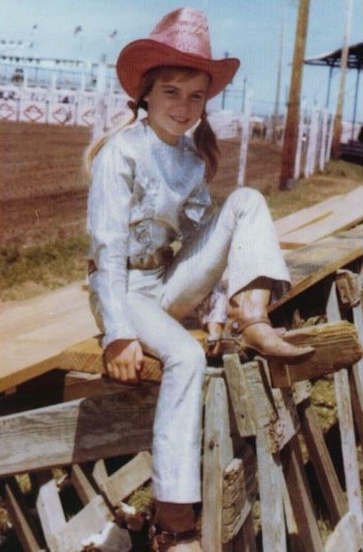 Ann Lewis sitting on fence
