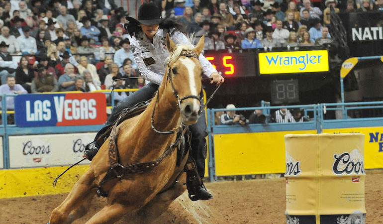 Brittany Pozzi riding with a hackamore