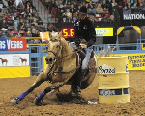 Cervi's balance with her hands, feet and seat keep her right with Stingray to achieve a quick and balanced turn at the 2009 National Finals Rodeo. CREDIT: Kenneth Springer