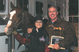 Mary Burger standing with Rare Fred and Ron Martin after winning the 2006 WPRA world championship