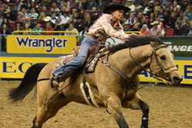 Mary Burger riding at the NFR
