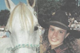 Bobbiann Womack standing with horse