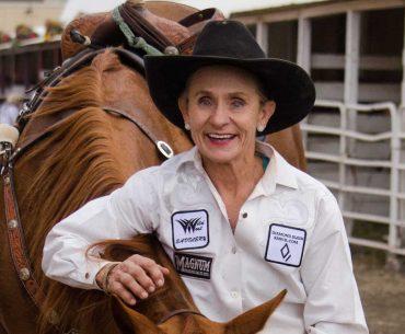 Cheyenne Allen standing next to horse