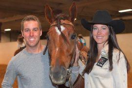 Hallie Hanssen standing with husband and horse Vida