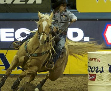 Hailey Kinsel turning the barrel in Round 1 of the National Finals Rodeo