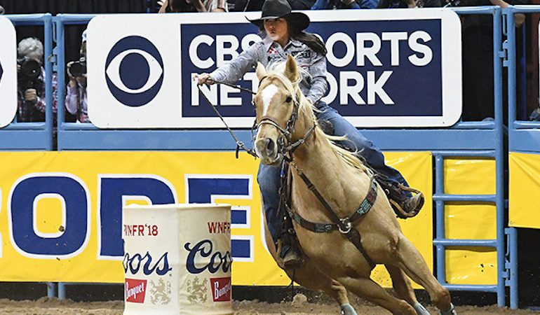 Hailey Kinsel and Sister Rounding the barrel at the WNFR
