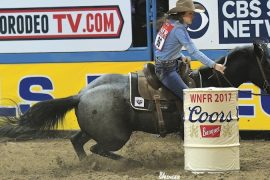 Nellie Miller turning the barrel at the National Finals Rodeo