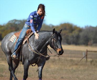 Ashley Schafer patting horse