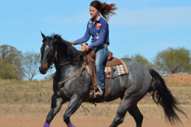 Ashley Schafer loping on horse