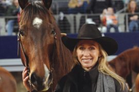 Charmayne James standing with horse