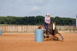 Lacey Harmon turning barrel on futurity horse