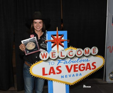 Hailey Kinsel standing with Fabulous Las Vegas sign
