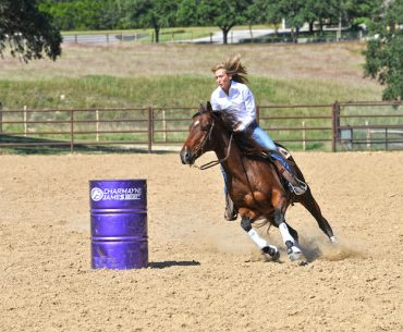 Charmayne James turning the barrel focusing on her horse's position to ensure proper timing on the barrel pattern
