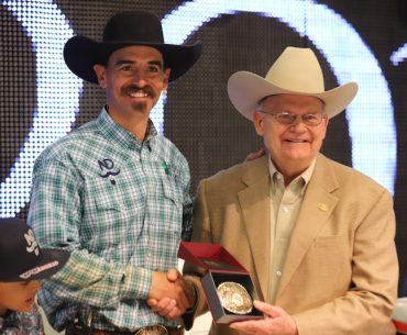 Nick Dowers accepting buckle from Dr. Blodgett at Road to the Horse