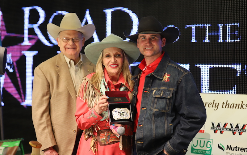 Wade Black accepting buckle from Tootie Bland after winning the Wild Card at Road to the Horse 2019