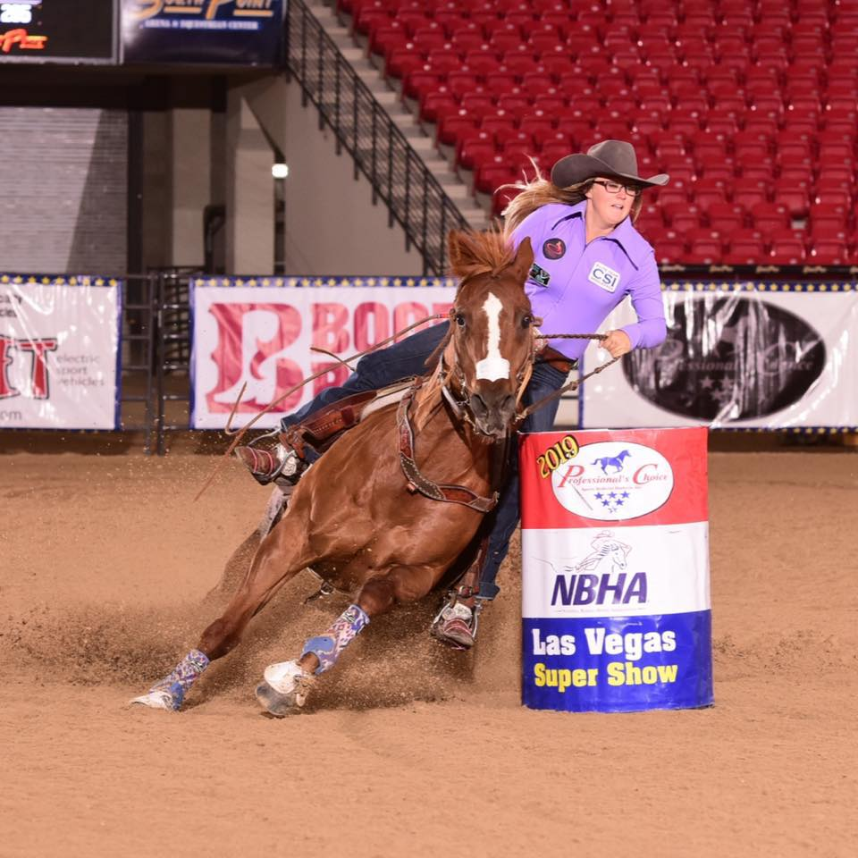 Cheyenne Lindsey and LL Cat Man Do turning a barrel