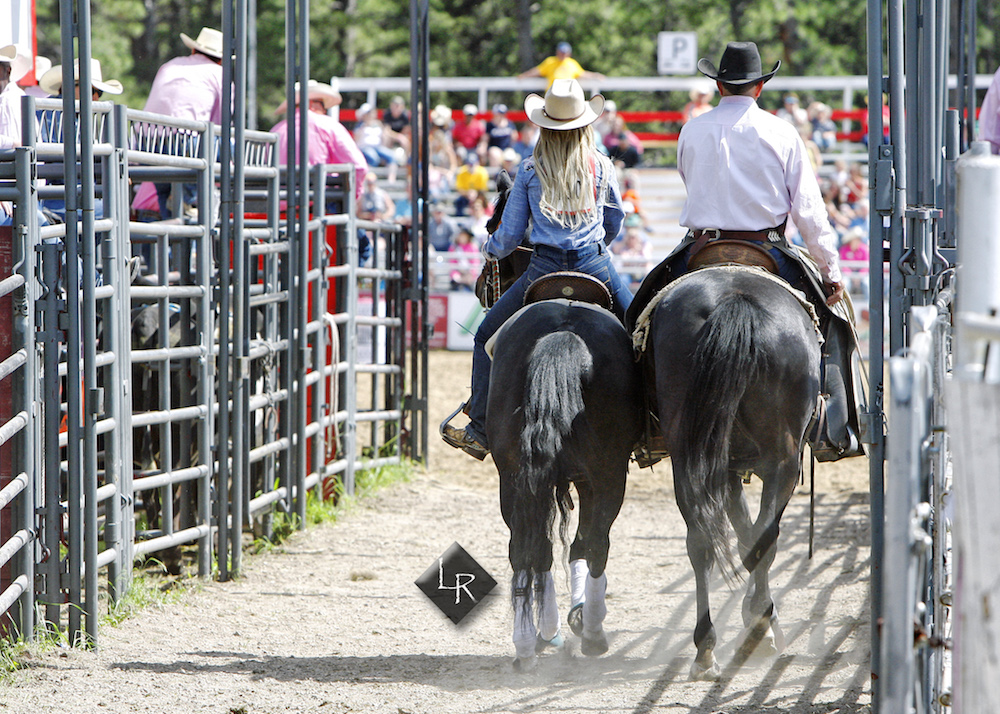 Amy Jo Reisdorfer riding down the alley at the Elizabeth Stampede