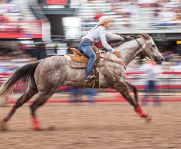 Stevi Hillman and MCM Imasharpguy running at 2017 Cheyenne Frontier Days