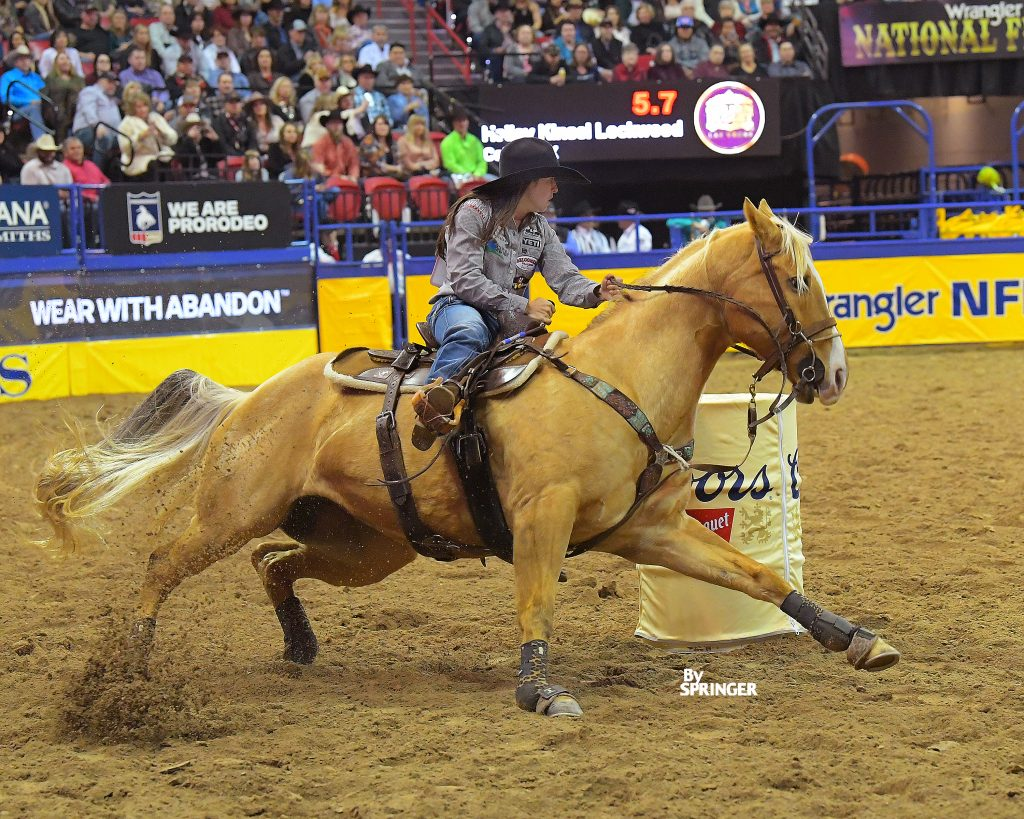 Hailey Kinsel and Sister turning the third barrel at the 2019 NFR