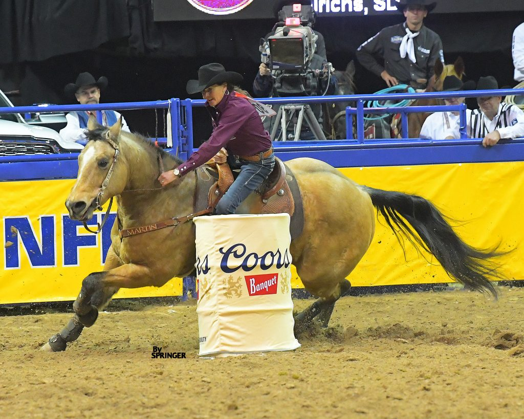 Lisa Lockhart and Louie turning the third barrel at the 2019 NFR