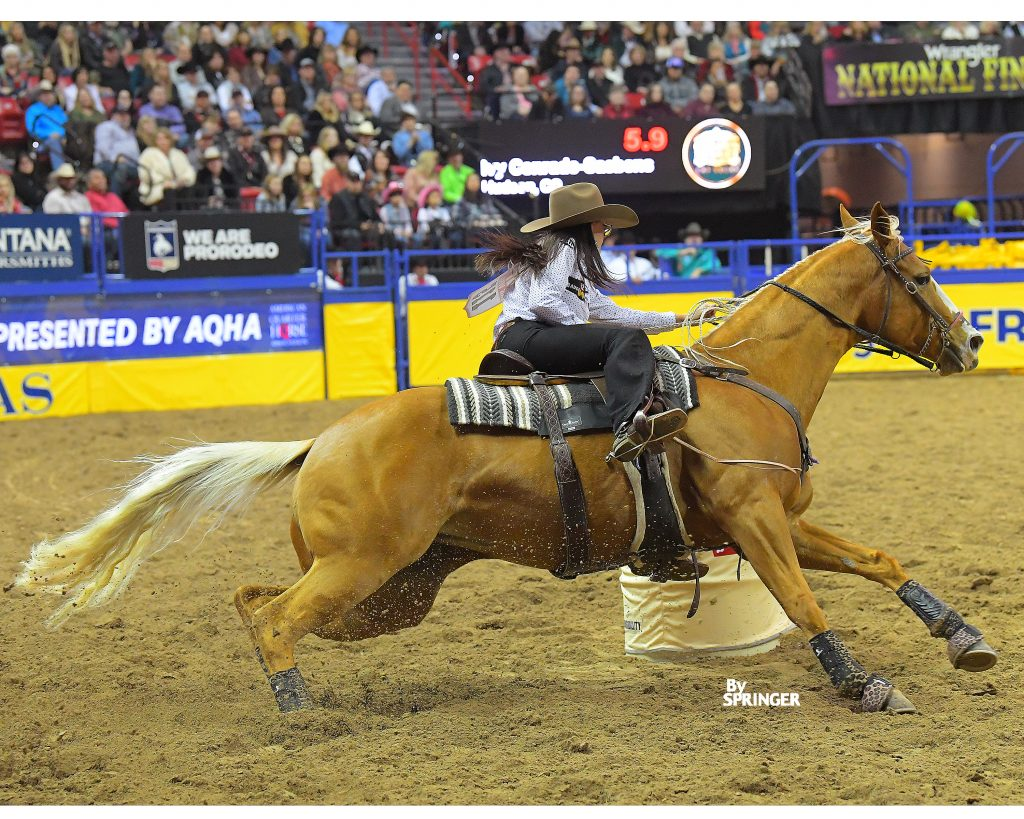 Ivy Conrado Saebens and KN Fabs Gift Of Fame turning the second barrel at the NFR