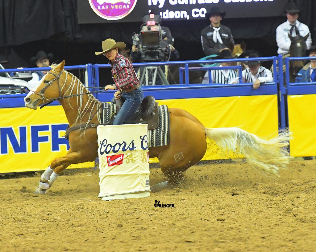 Ivy Conrado turns the third barrel at the 2019 NFR