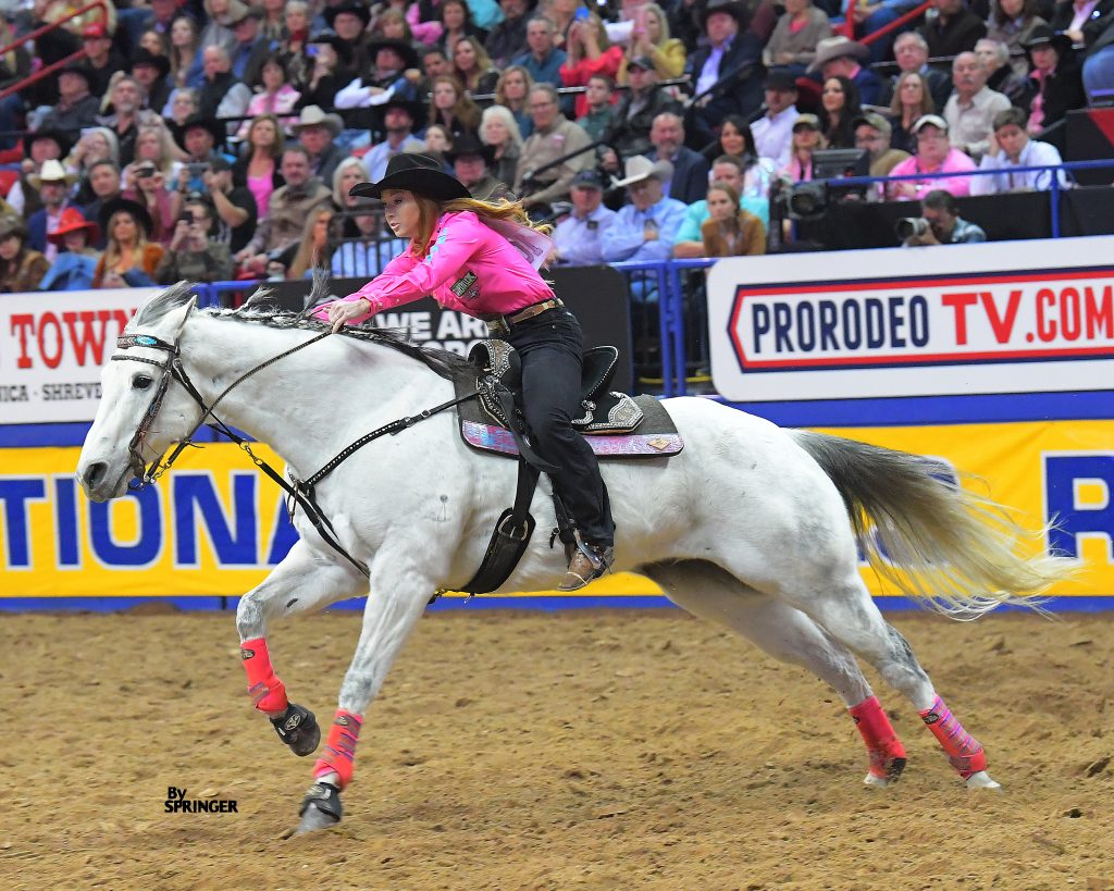 Emily Miller and Namgis D 33 running home at the NFR