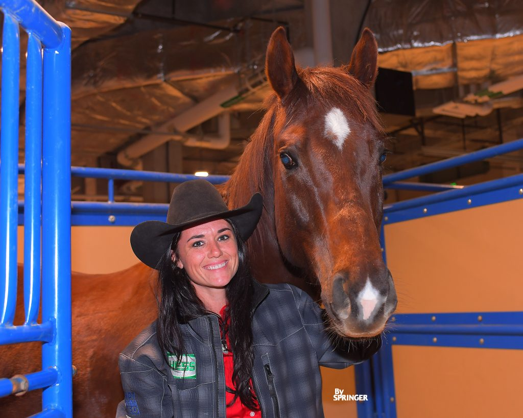Britany Diaz with horse in stall