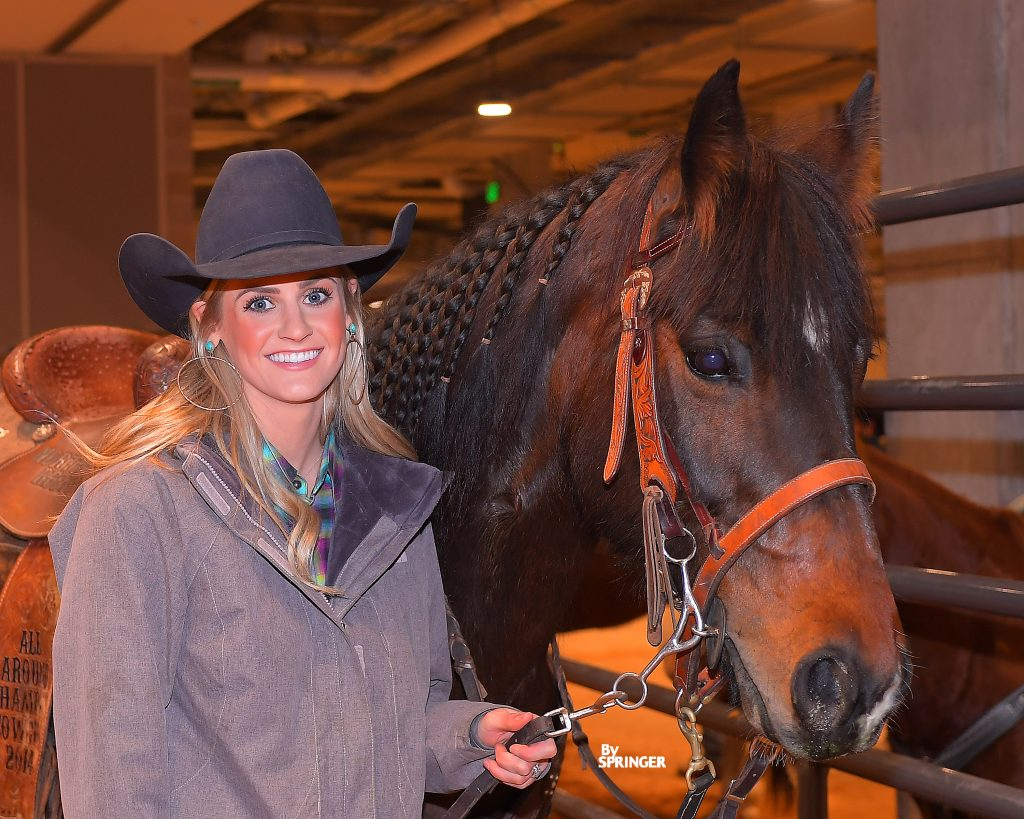 Callahan Crossley Tryan standing with Ranger at the Fort Worth Stock Show Rodeo