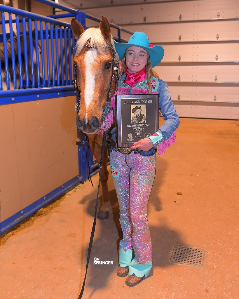 Jimmie Smith and Lena with the Jerry Ann Taylor Best Dressed Award at the Fort Worth Stock Show Rodeo