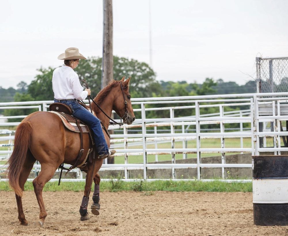 Janet Staton trotting horse up to barrel