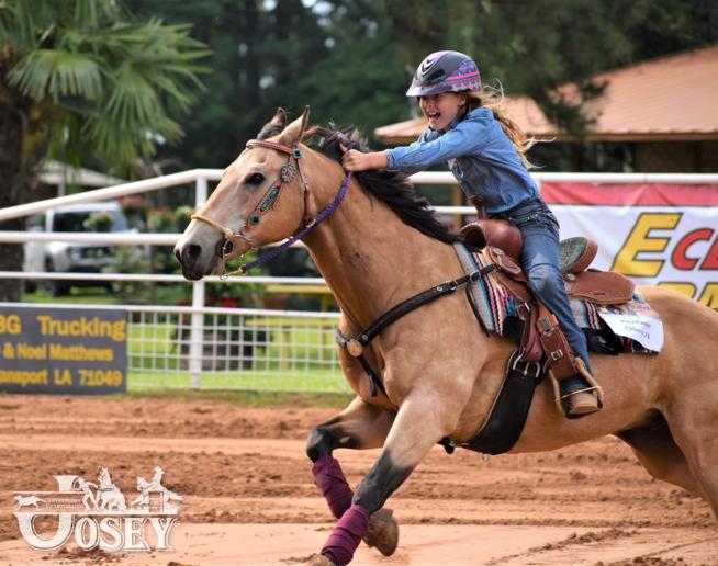 teenage girl running home barrel racing at the Josey Ranch