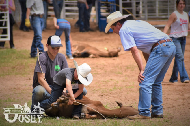 Josey Ranch roping instructor helping young boy