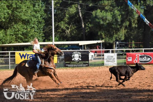 Breakaway roper at the Josey Ranch roping a calf