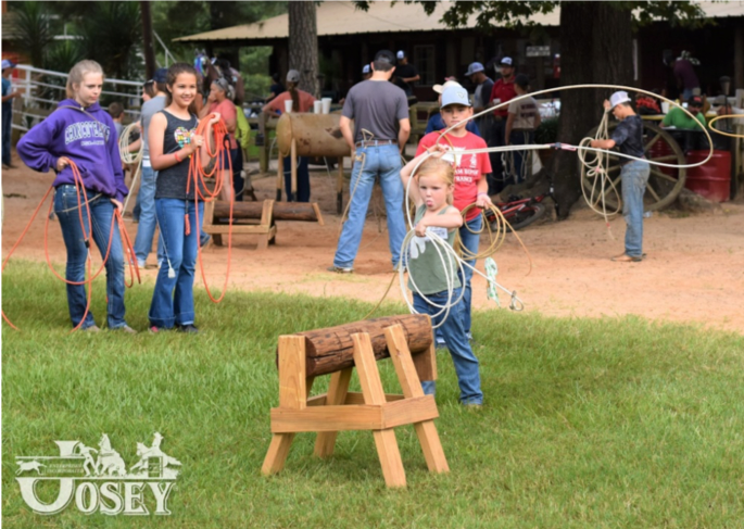 Young boy roping the dummy at Josey Ranch