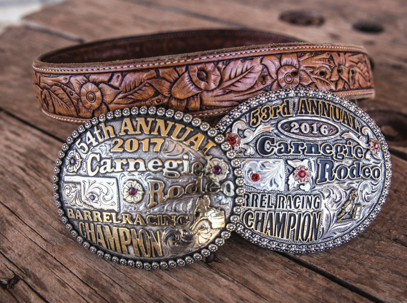Dona Kay Rule's belt buckles from the Carnegie Rodeo