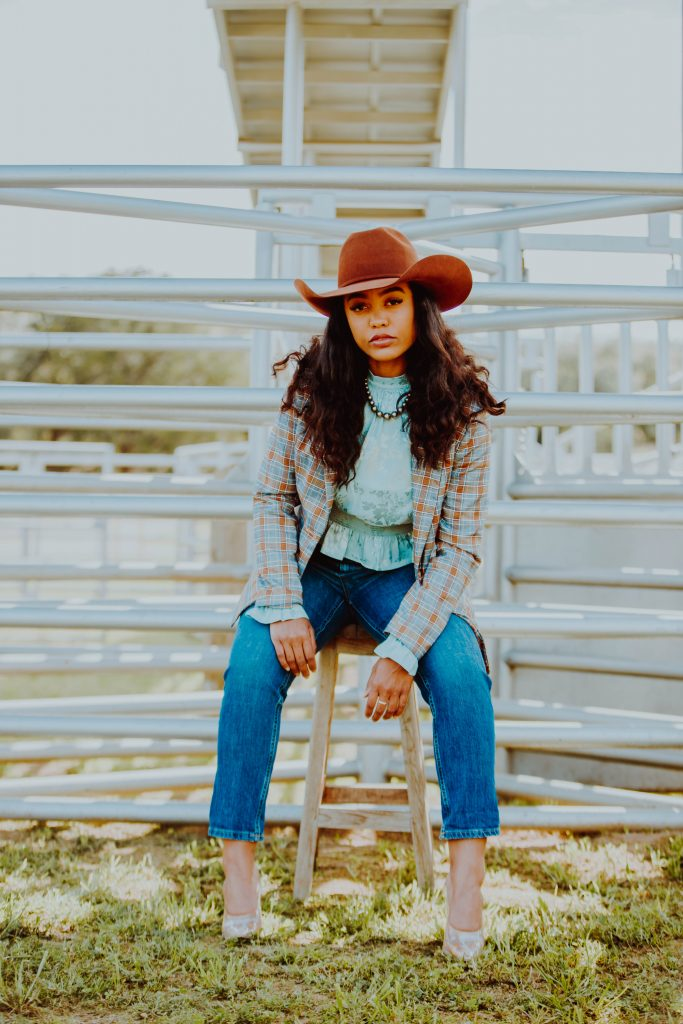 girl sitting at a rodeo
