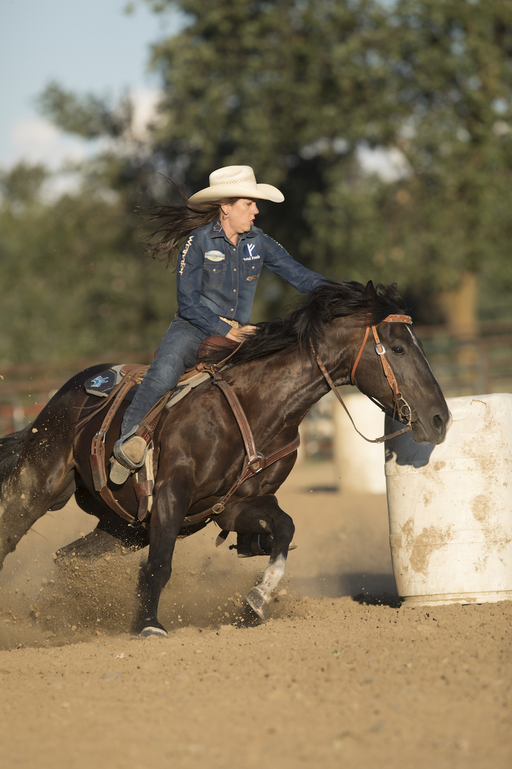 Nellie wants her horses working in four-wheel drive around the barrel for a smooth and efficient turn. • Photo by Ross Hecox