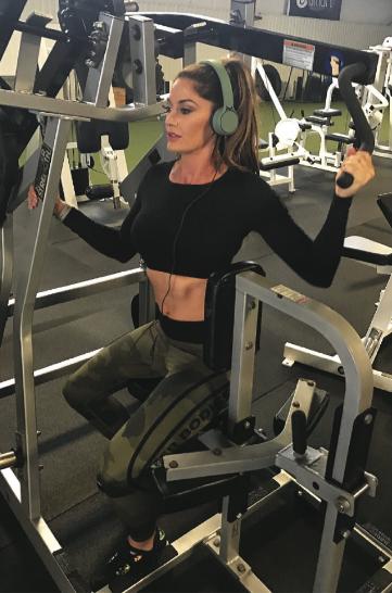 Fallon Taylor lifting weights