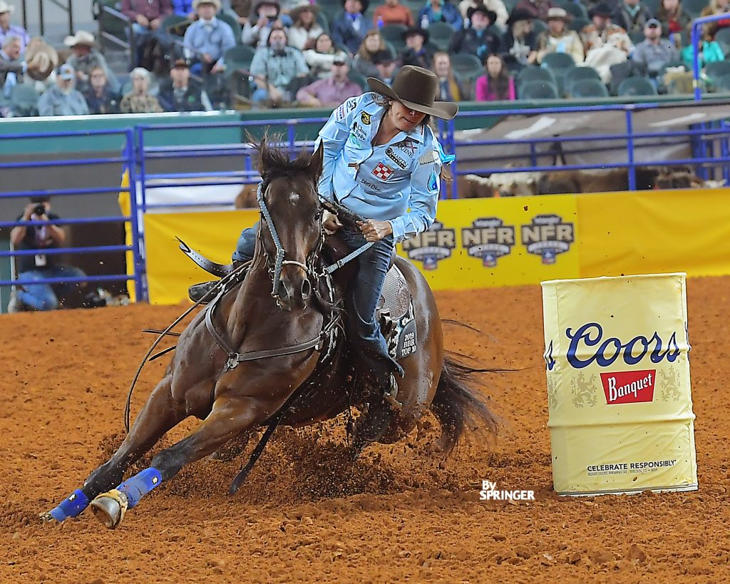 Ryann Pedone and JS Milo And Stitch turn a barrel at the Wrangler NFR