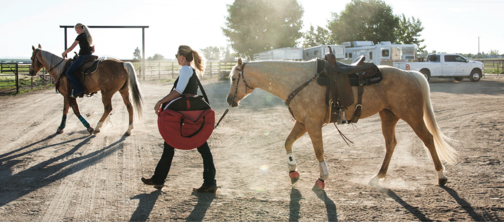 Jessie Telford leading a horse to the arena