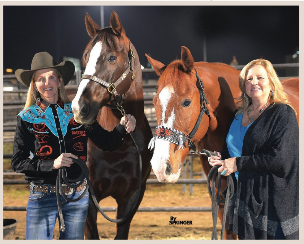 Cheyenne Wimberley and Robin Weaver standing with their horses at the 2019 NFR