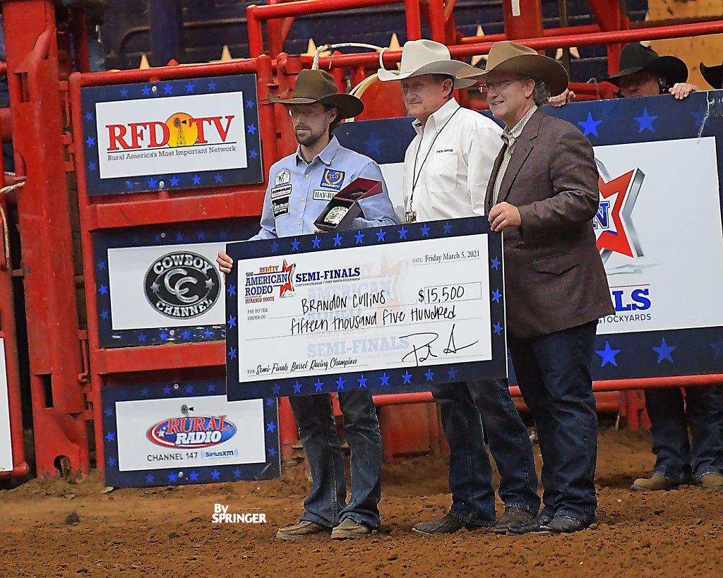 Brandon Cullins accepting big check