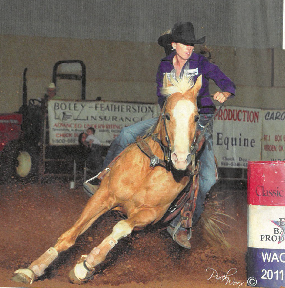 Kassie Mowry and Chasin Firewater turning a barrel in Waco Texas