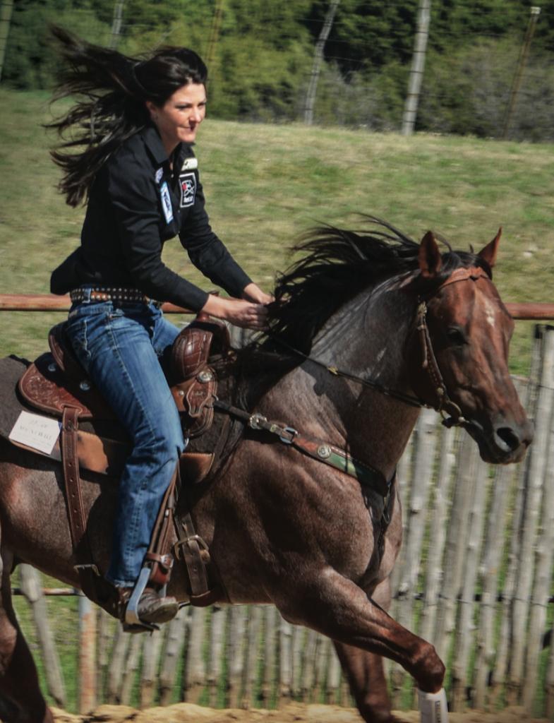Hallie Hanssen loping a horse