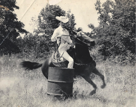 Martha Josey turning around a barrel in the pasture